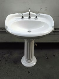 Porcelain sink with delta water fixture. Nice new! La Puente, 91746