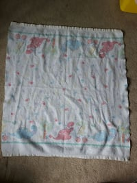 Baby blanket with dinosaurs and paw print