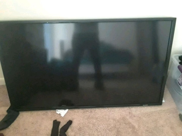 black flat screen TV with remote