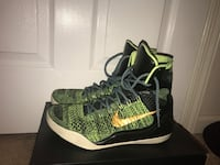Pair of green-and-black nike basketball shoes 310 mi