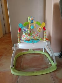 baby's white and green Fisher-Price learning walke