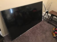 black flat screen TV with remote Gaithersburg, 20879