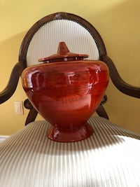 Red ceramic pot with lid