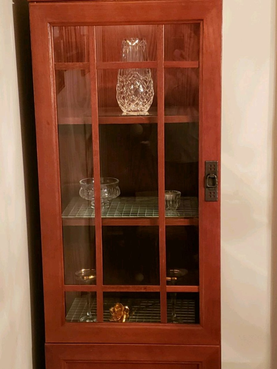 Two Lighted Cabinets With Storage