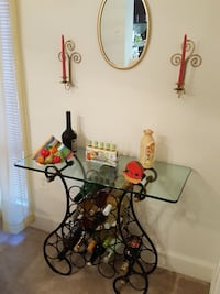 rectangular clear glass top black wrought metal framed console table with bottle rack Fairfax, 22031