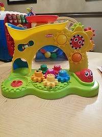 green and yellow Fisher-Price learning table