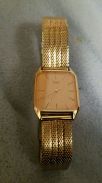 square gold analog watch with gold link bracelet Toronto, M3M 1J2