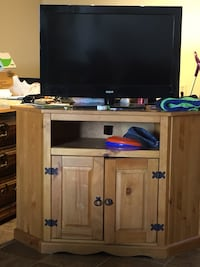 Flat screen television with brown wooden tv hutch Edmonton, T5T 3T1