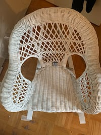 Small white wicker rocking chair