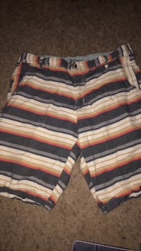 white, black, and red striped shorts