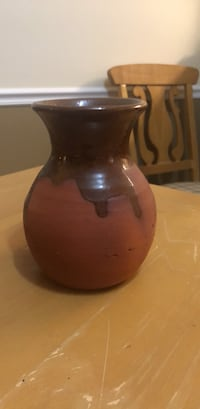 brown and black ceramic vase