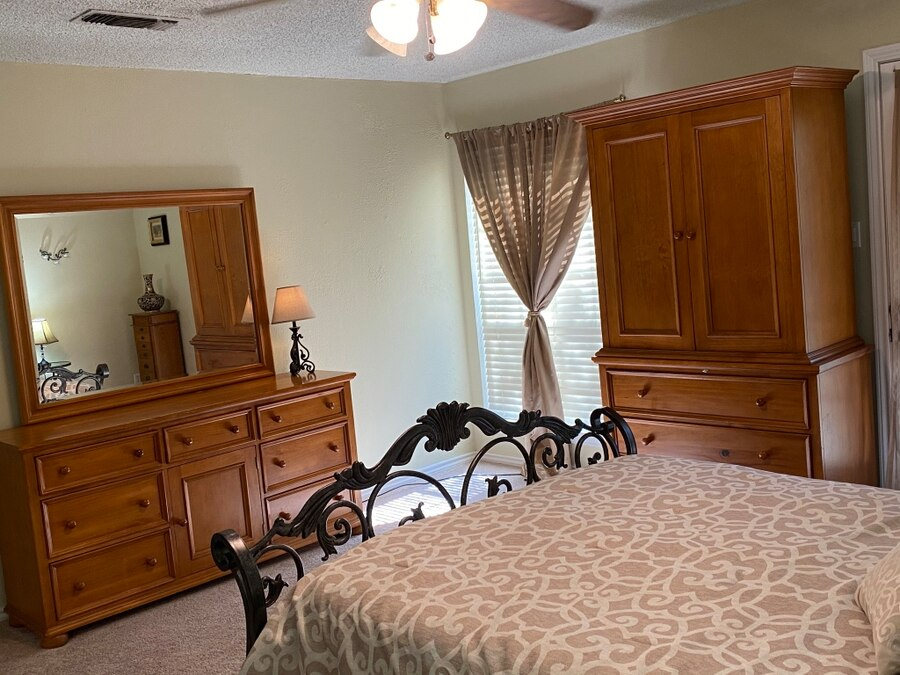 Photo Matching wood dresser and armoire with drawers