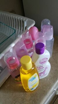 7 bottles, lotion and baby shampoo El Monte