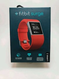Brand new red Fitbit Surge size large