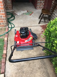 Red and black gas mower