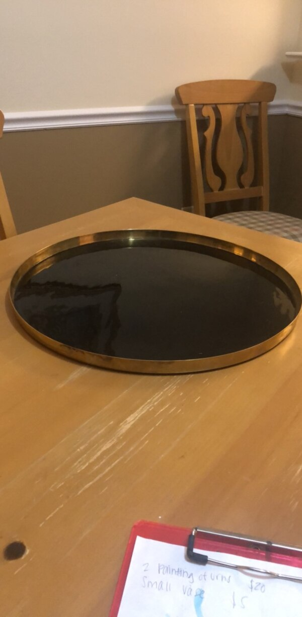 round brown wooden framed glass top coffee table