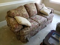 Floral formal sitting room couch. West Chester