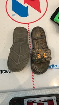 pair of brown-and-orange Under Armour tree camouflage slide sandals