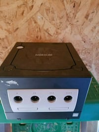 black and gray game cube 239 mi