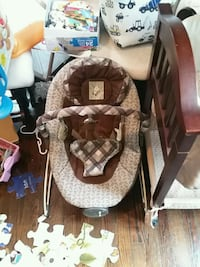 baby's brown and white cradle and swing Fitchburg, 01420