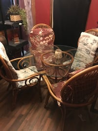 Wicker chairs and glass-top table
