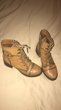 pair of brown leather cap-toe side-zip boots