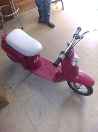 red and white motor scooter 1490 mi