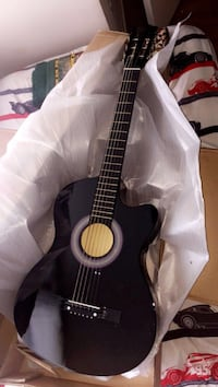 black and brown classical guitar 19 km