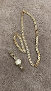 gold chain necklace, bracelet and round gold analog watch
