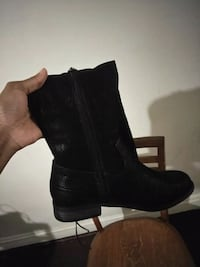 pair of black leather boots 69 km