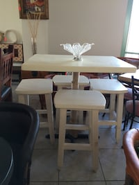 white wooden pedestal dining set