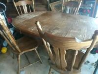 round brown wooden table with four chairs dining s New Iberia