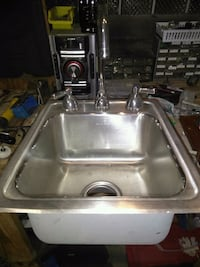 Stainless steel sink w 2 faucets