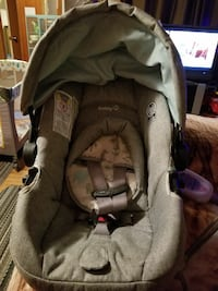 baby's gray Child Safety seat car seat carrier