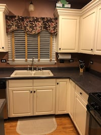 Kitchen cabinets, island and countertops
