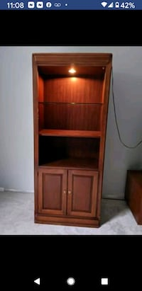 Lighted Thomasville bookcase  77x  36x 16 it's.