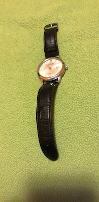 round silver analog watch with black leather strap West Chicago, 60185