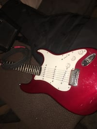 Red and white stratocaster electric guitar North Platte, 69101