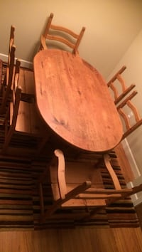 Oval brown wooden table with six chairs dining set Coquitlam, V3K 3V2