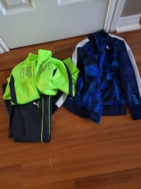 two green and blue zip-up jackets