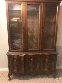 brown wooden framed glass display cabinet 37 mi