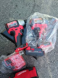 two red and black Milwaukee cordless power tools Scarborough, M1V
