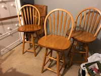three brown wooden windsor chairs Miami, 33177