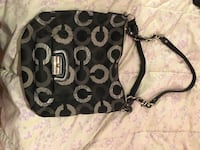 black and gray Coach handbag