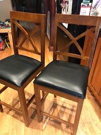 two black leather padded chairs Toronto
