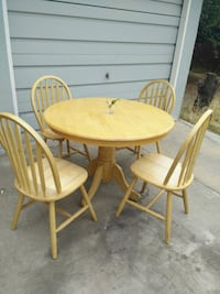 round brown wooden table with four chairs dining s Los Angeles, 90023