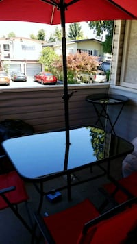 Patio table chairs and Umbrella and bar table Burnaby, V5G 1T8
