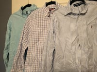 3 men's shirts.  2 are Ralph Lauren size M and 1 is Vineyard Vine size L.  In excellent condition no stains  Alexandria, 22309