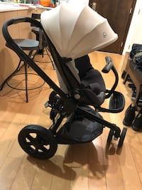 baby's black and gray stroller Los Angeles, 91601