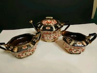 two brown-and-black ceramic teapots 527 km